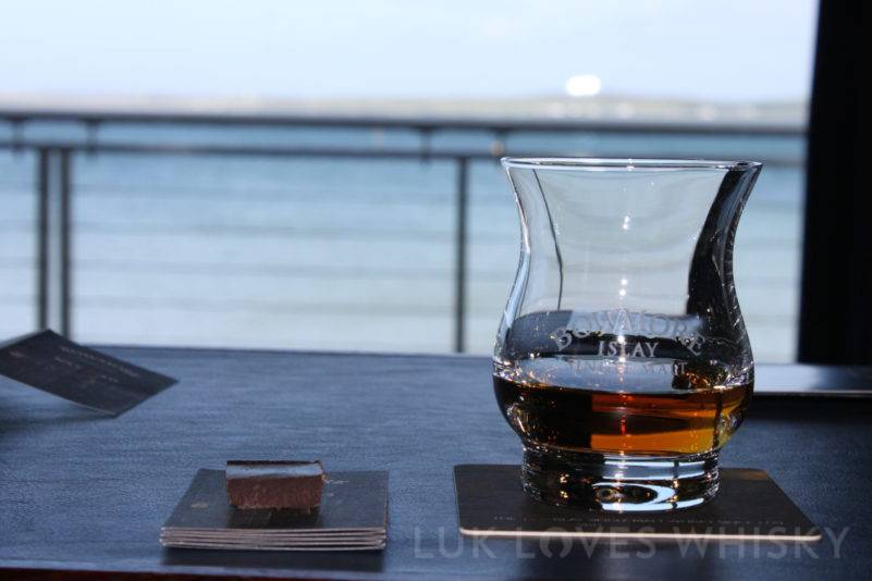 Bowmore 15 years old goes well with the dark chocolate, on the other side of the bay Bruichladdich Distillery, Bowmore Distillery